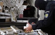 Percheziţii la persoane bănuite de evaziune fiscală cu ţigarete