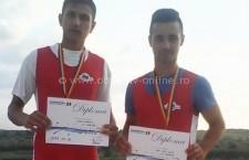 Călărași/Canotorii Milea Gabriel şi Raiu Elvis Ionuţ au cucerit primele lor medalii şi titluri de campioni
